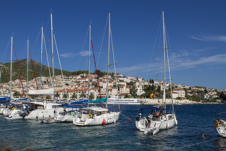 ini: STARI GRAD, CROATIA - SEPTEMBER 8, 2014: Boats at marina ini Stari Grad on Hvar island, Croatia. Stari Grad (Pharos) is the oldest town in Croatia and one of the oldest towns in Europe Editorial