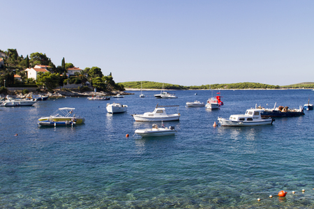 STARI GRAD, CROATIA - SEPTEMBER 8, 2014: Boats at marina ini Stari Grad on Hvar island, Croatia. Stari Grad (Pharos) is the oldest town in Croatia and one of the oldest towns in Europe Editorial