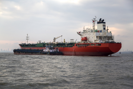 MUMBAI, INDIA - OCTOBER 11, 2015: Industrial ship in the waters of Mumbai. The port and shipping industry employs many residents directly and indirectly.