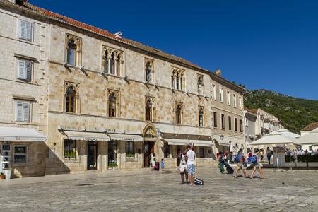 starigrad: STARI GRAD, CROATIA - JULY 1, 2014: Unidentified people in Stari Grad on Hvar island, Croatia. Stari Grad (Pharos) is the oldest town in Croatia and one of the oldest towns in Europe Editorial