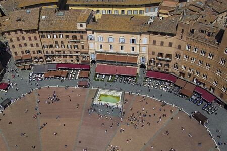 campo: SIENA, ITALY - MAY 26, 2016: Unidentified people at Piazza del Campo in Siena, Italy. Piazza del Campo is the principal public space of the historic center of Siena Editorial