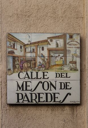 12 13: MADRID, SPAIN - MARCH 13, 2016 : Closeup of the street sign. Street signs in Madrid are hand-painted ceramic tiles typically composed within 9 or 12 tiles. They depict the name of the alley or street. Editorial