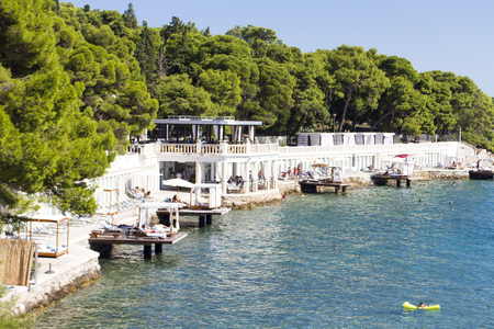 pharos: STARI GRAD, CROATIA - JULY 1, 2014: Unidentified people at Stari Grad on Hvar island, Croatia. Stari Grad (Pharos) is the oldest town in Croatia and one of the oldest towns in Europe Editorial