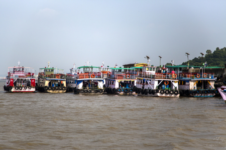 government services: MUMBAI, INDIA - OCTOBER 11, 2015: Ferries in Mumbai. Water transport in Mumbai consists mostly of ferries. Services are provided by both government agencies as well as private partners.