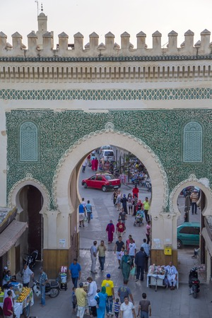 bab: FES, MOROCCO - SEPTEMBER 14, 2014: Unidentified people at Bab Bou Jeloud gate (Blue Gate) in Fez, Morocco in Fes, Morocco. With a population of 1.1 million, Fez is the second largest city of Morocco.