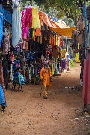 fleamarket: ANJUNA, INDIA - OCTOBER 14, 2015: Unidentified man on th flea market in Anjuna, India. Anjuna flea market runs from dawn till dusk every Wednesday. Editorial