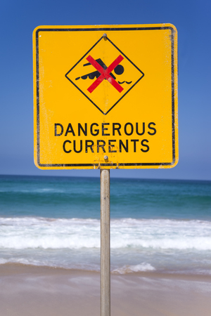 currents: Dangerous currents sign on the beach in Australia Stock Photo