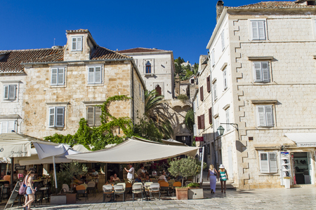 pharos: STARI GRAD, CROATIA - JULY 1, 2014: Unidentified people in Stari Grad on Hvar island, Croatia. Stari Grad (Pharos) is the oldest town in Croatia and one of the oldest towns in Europe Editorial