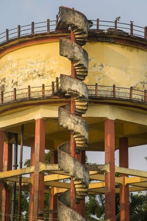 backwaters: Closeup of the spiral staircase on old water tower in backwaters of Kerala, India