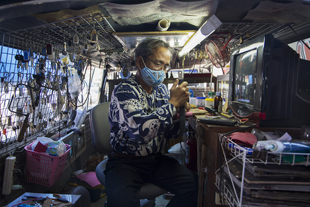 culturally: CHIANG MAI, THAILAND - JANUARY 31, 2016: Unidentified man on the market in Chiang Mai, Thailand. Chiang Mai is the largest and most culturally significant city in Northern Thailand.