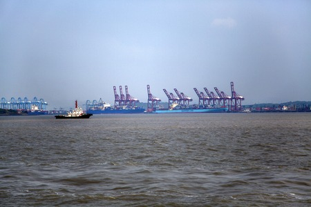 MUMBAI, INDIA - OCTOBER 11, 2015: Cargo ship at Jawaharlal Nehru Port in Mumbai. This port, also known as Nhava Sheva, is the largest container port in India.