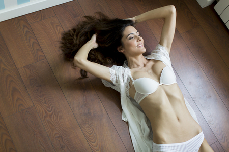 seductive women: Woman in lingerie laying on the floor