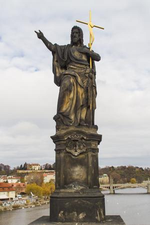 Statue of St. John the Baptist on Charles Bridge in Prague, Czech Republic