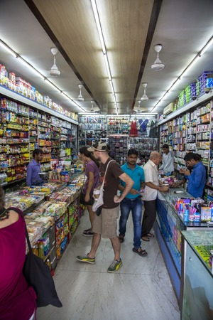 agglomeration: MUMBAI, INDIA - OCTOBER 9, 2015: Unidentified people in the shop  in Mumbai, India. With 12 million people, Mumbai is the most populous city in India and the 9th most populous agglomeration in the world. Editorial
