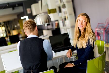 robo: Young business people sitting in the office and working together