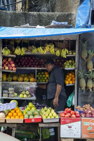 agglomeration: MUMBAI, INDIA - OCTOBER 10, 2015: Unidentified man on the market in Mumbai, India. With 12 million people, Mumbai is the most populous city in India and the 9th most populous agglomeration in the world.