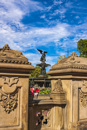 angels fountain: NEW YORK, USA - AUGUST 17, 2016: Unidentified people by Bethesda fountain in Central Park in New York. Fountain was creted in 1864. Editorial