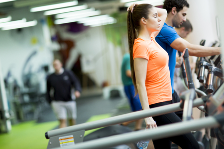 crosstrainer: Young people training on a cross trainer