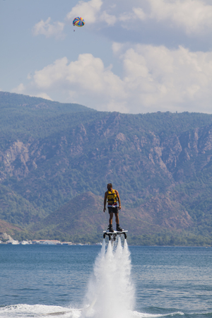 invented: MARMARIS, TURKEY - SEPTEMBER 17, 2014: Unidentified man on flyboard at Marmaris, Turkey. Flyboard was invented in spring 2011 by a French watercraft rider, Franky Zapata.
