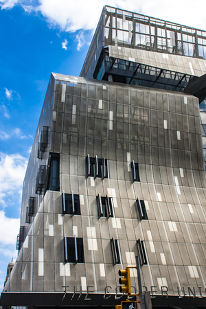 NEW YORK, USA - AUGUST 16, 2016: 41 Cooper Square building in New York. It was designed by architect Thom Mayne and was opned at 2009.
