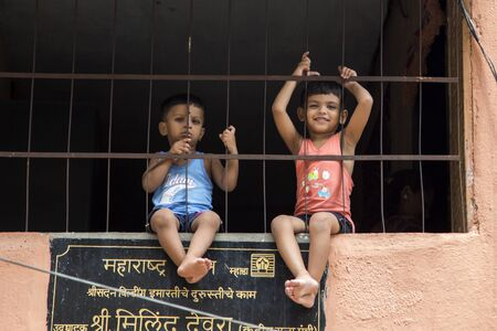 agglomeration: MUMBAI, INDIA - OCTOBER 9, 2015: Unidentified children on the street of Mumbai, India. With 12 million people, Mumbai is the most populous city in India and the 9th most populous agglomeration in the world.