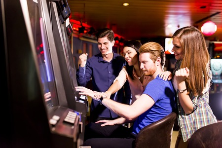 jackpot: Young people play jackpot in the casino Stock Photo
