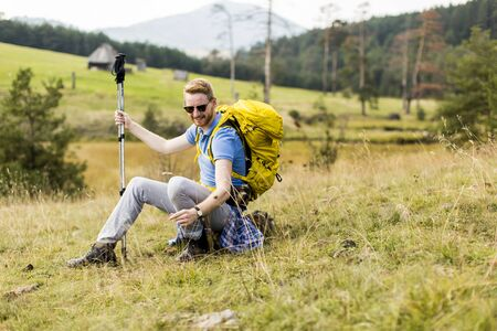 backpacking: Young backpacking man rest at the hill Stock Photo