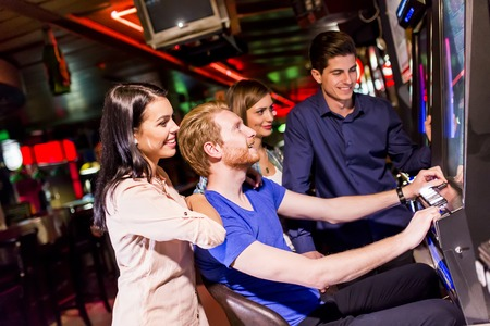 Young people play jackpot in the casino Stock Photo