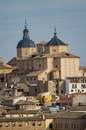 Church of Saint John the Baptist and dome of Jesuit church in Toledo, Spain Stock Photo