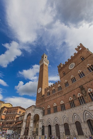 SIENA, ITALY - SEPTEMBER 21, 2016: Unidentified people at Piazza del Campo in Siena. It was built in 13th century and is regarded as one of Europe greatest medieval squares Editorial