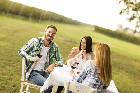 romantic man: Young people enjoy dinner and wine tasting in the vineyard