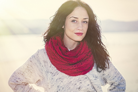 red scarf: Cute young woman with red scarf in the park