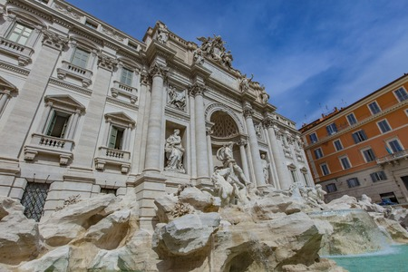 Trevi Fountain is a fountain in the Trevi district in Rome, Italy, designed by Italian architect Nicola Salvi and completed by Pietro Bracci at 1762. Stock Photo