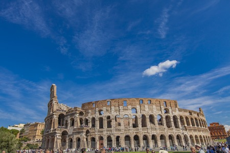 ROME, ITALY - SEPTEMBER 24, 2016: Unidentified people by Colosseum in Rome, Italy. It was opened at 80AD and is the largest amphitheatre ever built. Editorial