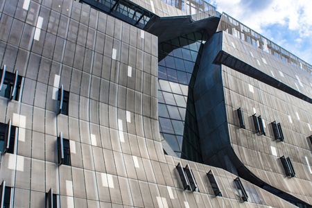 cooper: NEW YORK, USA - AUGUST 16, 2016: 41 Cooper Square building in New York. It was designed by architect Thom Mayne and was opned at 2009.