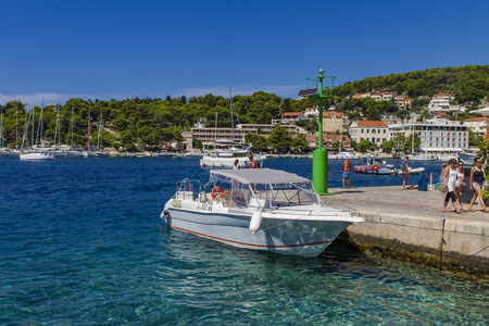 starigrad: STARI GRAD, CROATIA - SEPTEMBER 8, 2014: Unidentified people in Stari Grad at Hvar island, Croatia. Hvar island is popular tourist destination.