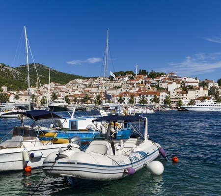 grad: STARI GRAD, CROATIA - SEPTEMBER 8, 2014: Unidentified people in Stari Grad at Hvar island, Croatia. Hvar island is popular tourist destination.
