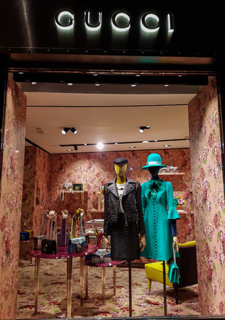 FLORENCE, ITALY-SEPTEMBER 21, 2016: Gucci luxury bags, clothes and shoes sit displayed for sale inside a Gucci store. Editorial