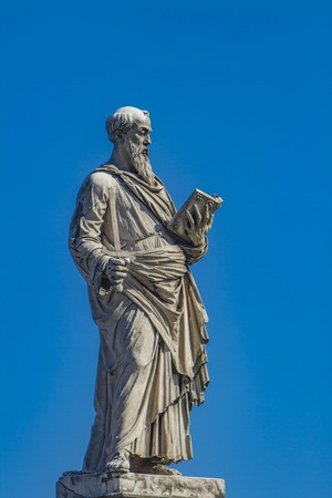 Saint Peter statue with key, book and papal coat of arms from Sant Angelo bridge in Rome, Italy