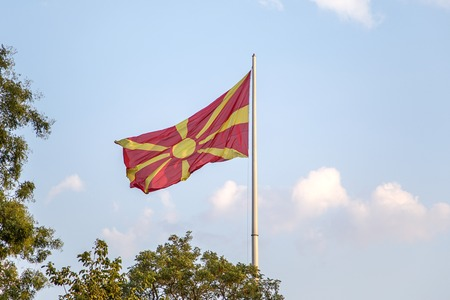 macedonian flag: Macedonian flag wacing on a wind on a flagpole Stock Photo