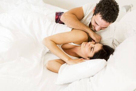 nightwear: Young loving couple in the bed