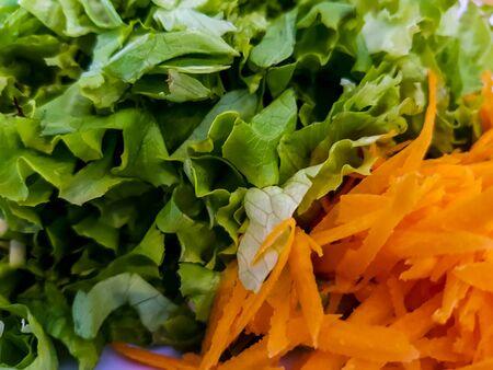 carot: Closeup view at carot and green salad