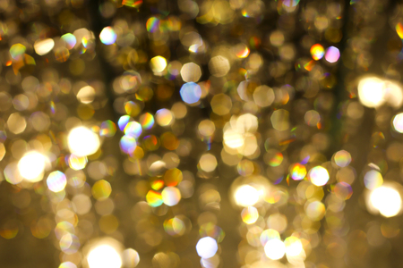new years background: Abstract background with yellow bokeh light for happy new year day, christmas and other events