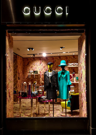 gucci store: FLORENCE, ITALY-SEPTEMBER 21, 2016: Gucci luxury bags, clothes and shoes sit displayed for sale inside a Gucci store. Editorial