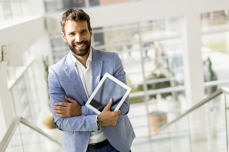 View of businessman with  tablet in the office