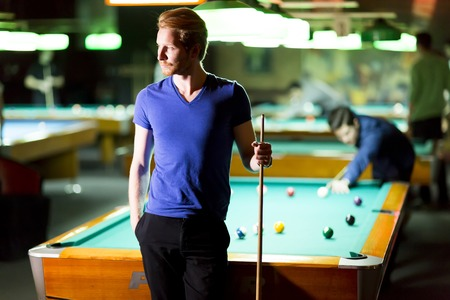 Portrait of a young man playing snooker Stock Photo