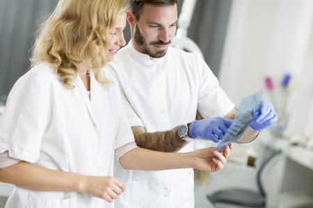 examine: Dental specialist examine an x-ray of the tooth Stock Photo