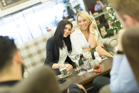 caffee: Young women sitting in the cafe and talking