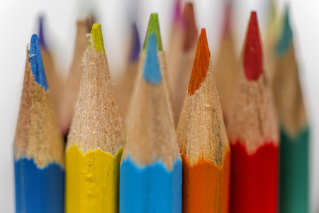 Close up view at colored drawing pencils in a variety of colors