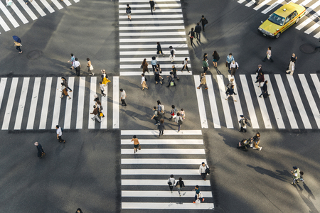 megacity: TOKYO, JAPAN- OCTOBER 12, 2016:  Unidentified people crossing the busy street in Ginza, Tokyo.It is a popular upscale shopping area of Tokyo. Editorial
